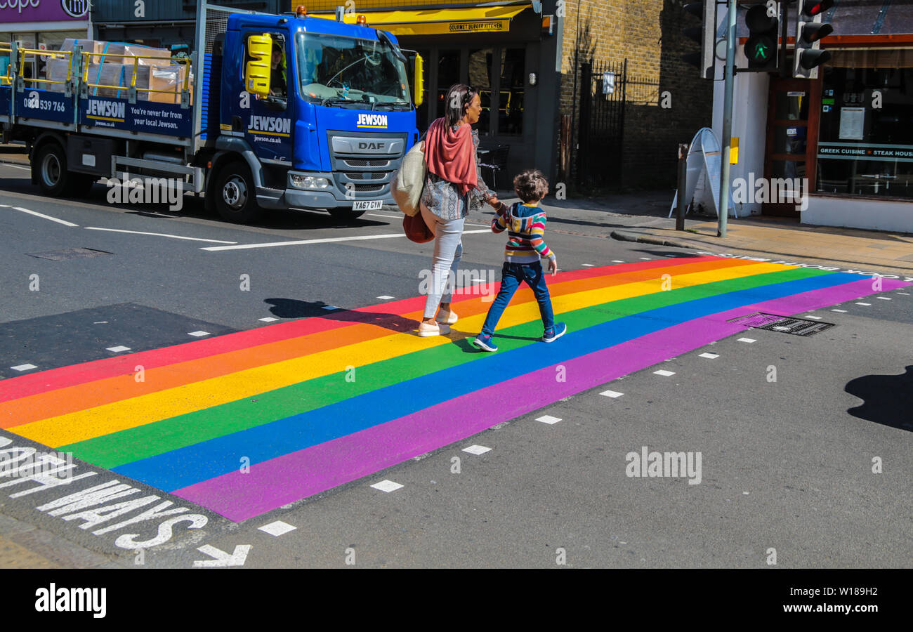 Wimbledon  UK 01 July 2019Wimbledon is painting the town rainbow ,ahead of Pride London this week end. A pedestrian crossing painted with rainbow colours in Wimbledon high Street.Paul Quezada-Neiman/Alamy Live News Stock Photo