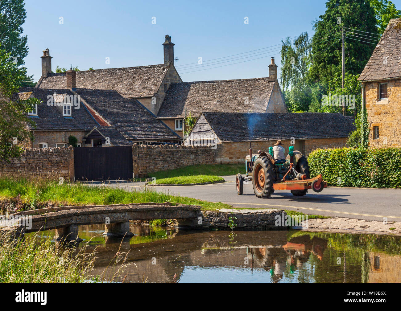 Village life In Lower Slaughter. - Stock Image