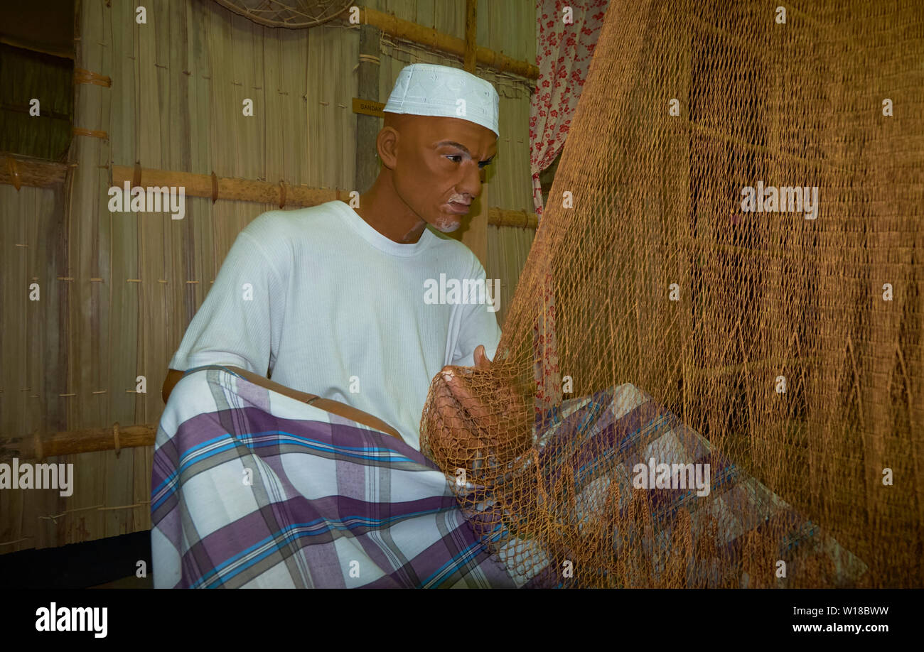 Diorama of a Kampong fisherman fixing nets in the Malay Technology Museum in Bandar Seri Begawan, Brunei - Stock Image