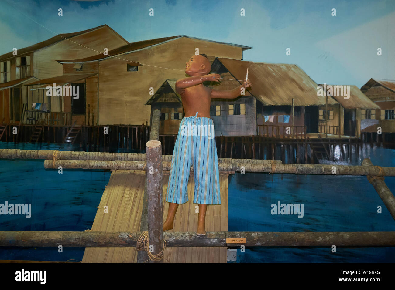 Diorama of a Kampong boy flying a kite in the Malay Technology Museum in Bandar Seri Begawan, Brunei - Stock Image
