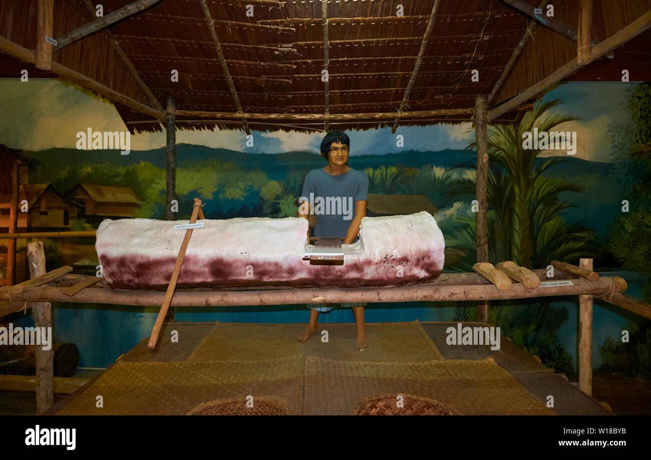 Diorama of a Kampong man scraping sago in the Malay Technology Museum in Bandar Seri Begawan, Brunei - Stock Image