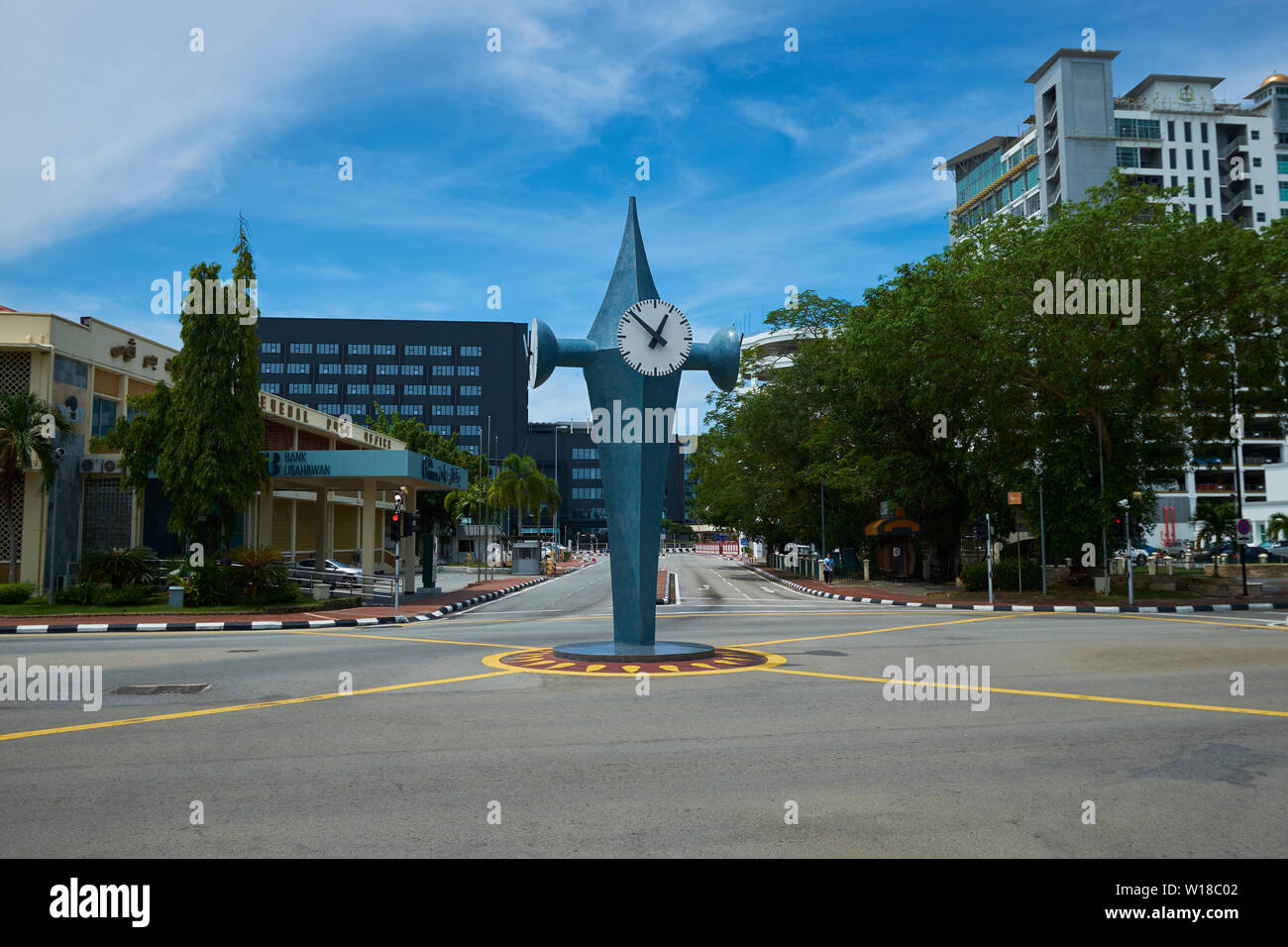 Four faced clock in a downtown intersection in Bandar Seri Begawan, Brunei - Stock Image