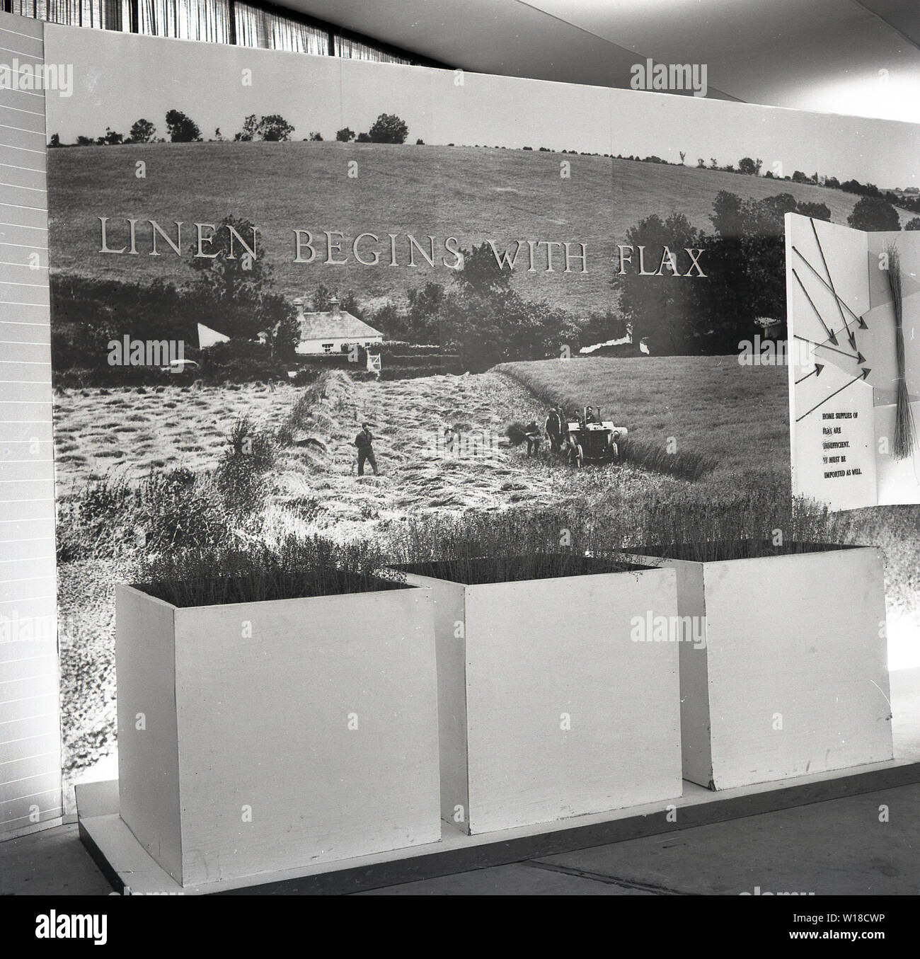 1960s, historical, Promotional display stand for Irish Linen at a Northern Ireland agricultural show with the caption, ' Linen Begins With Flax', stressing quality of Irish linen comes from the quality of the flax, at the time an important food and fiber crop cultivated in the country and one that had been grown in Ireland since the 11th century. - Stock Image