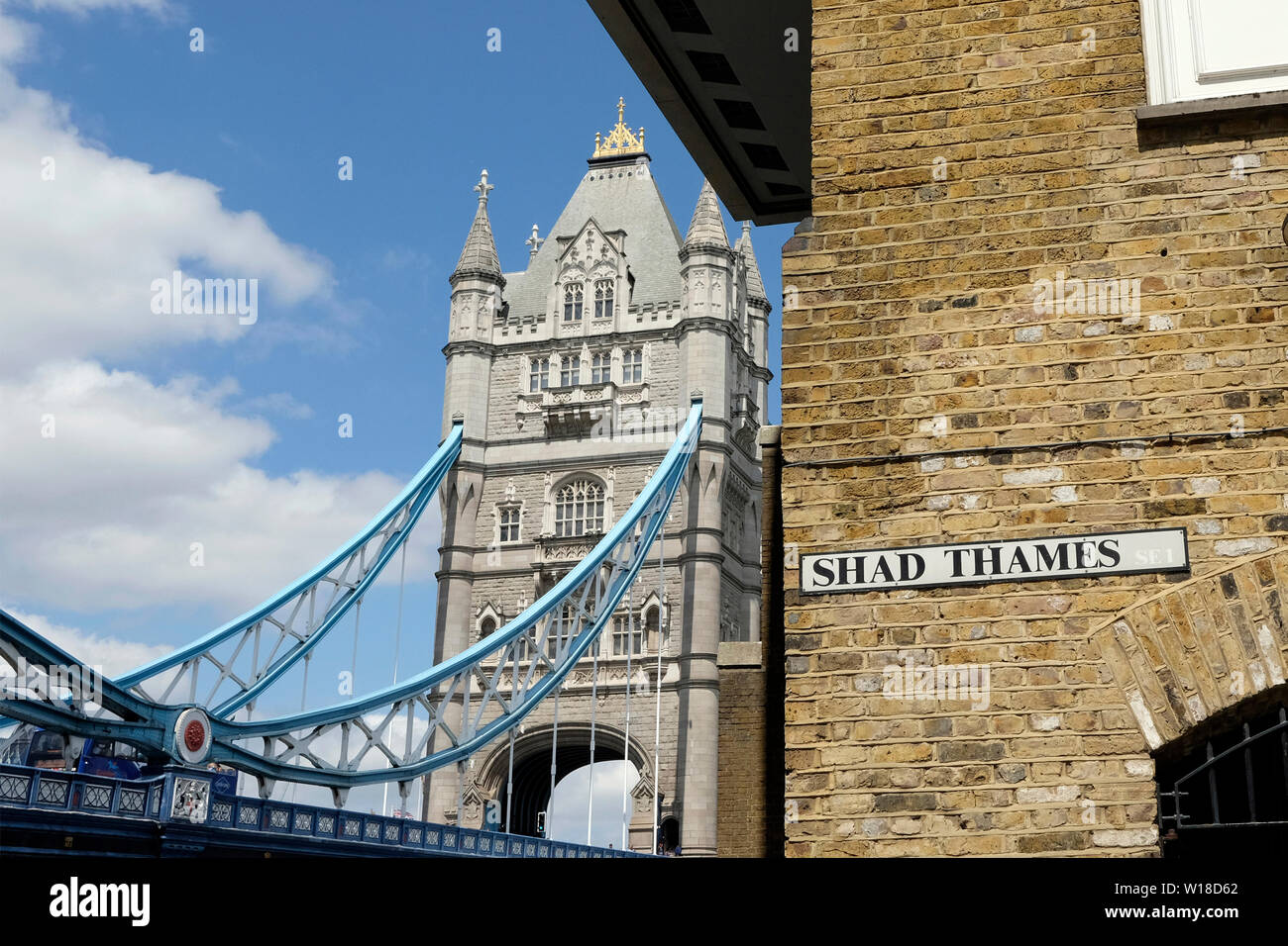 Shad Thames and Tower Bridge - Stock Image