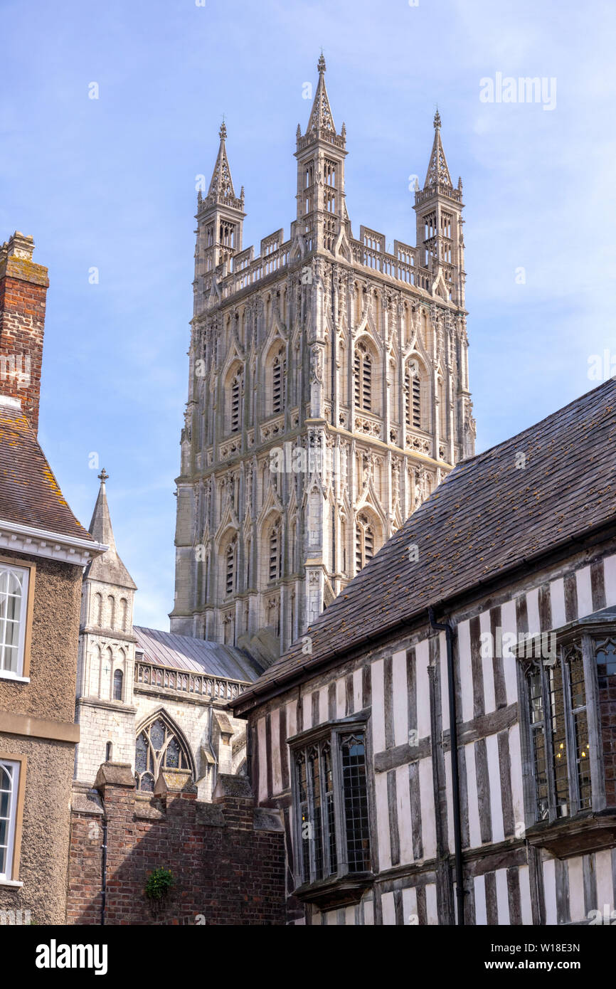 The beautifully carved and decorated 15th century tower of Gloucester Cathedral which rises to a height of 225 feet (69m), viewed from Millers Green - Stock Image