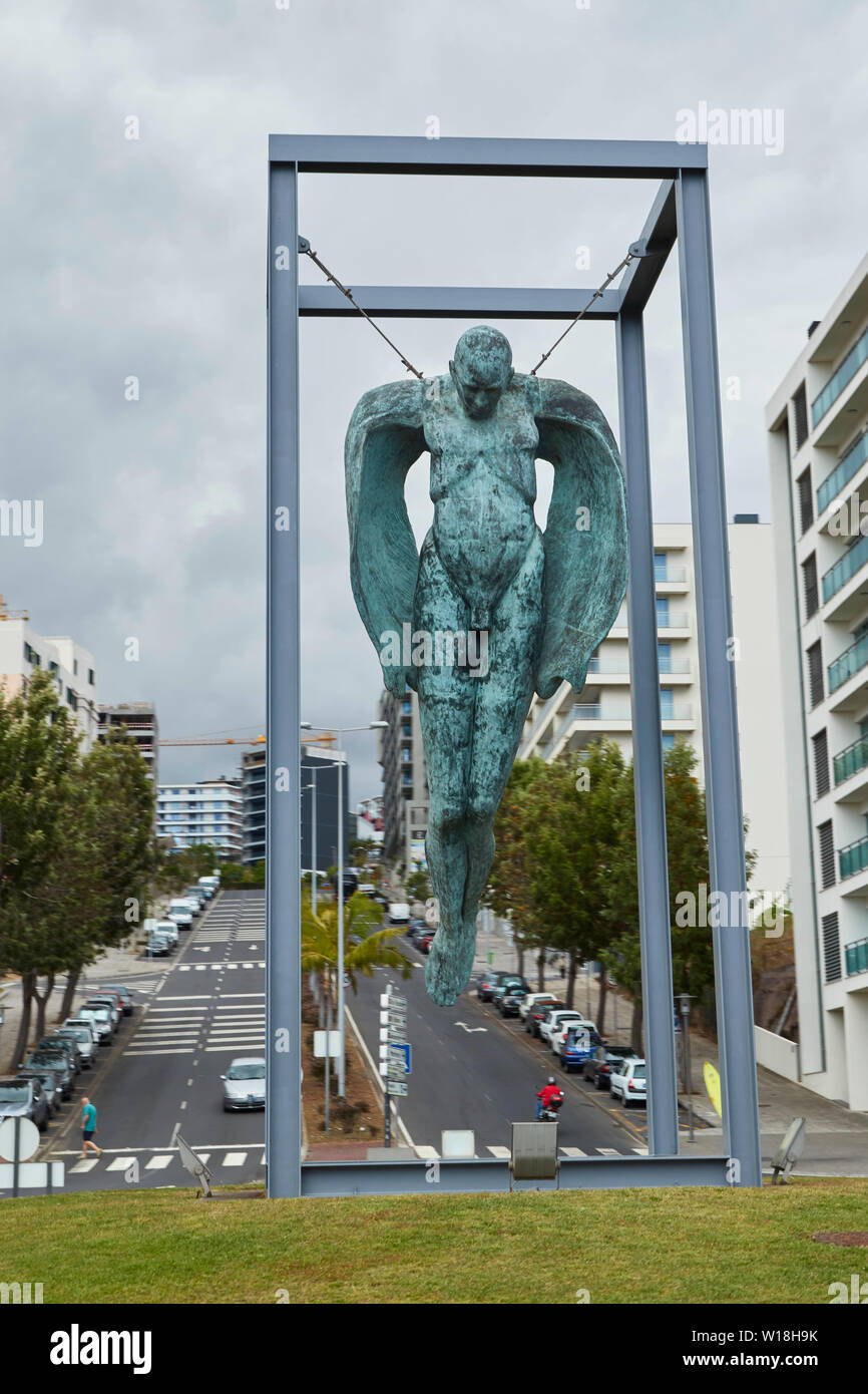 Hanging angel street art memorial to Maderian workers, Funchal, Madeira, Portugal - Stock Image