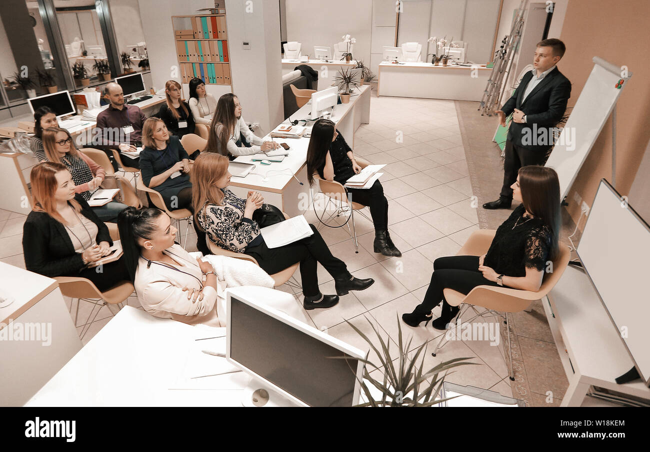 businessman holding a conversation with the employees of the company.the concept of teamwork - Stock Image
