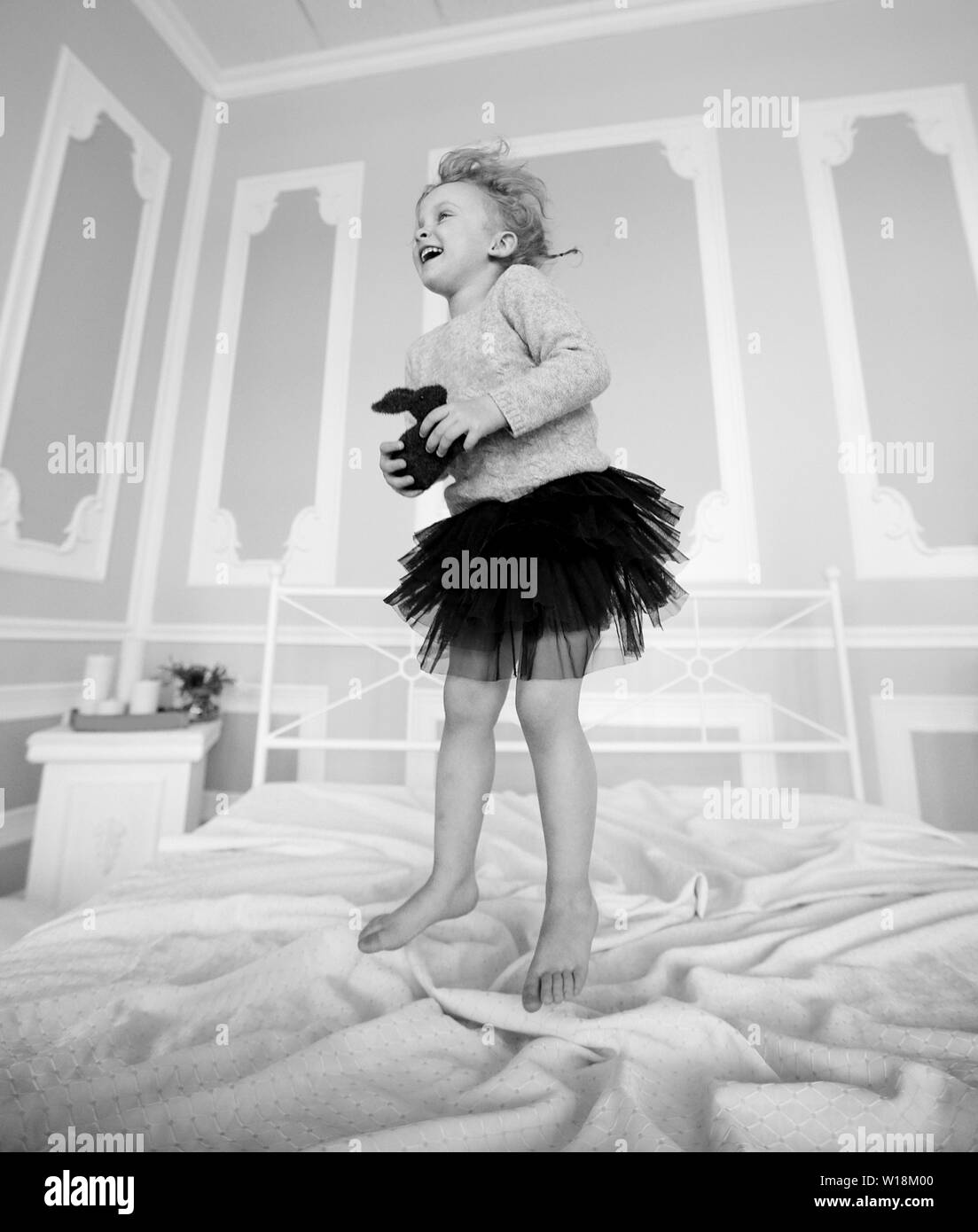 12d7c537 naughty little girl jumping on parent's bed.childhood and family concept -  Stock Image