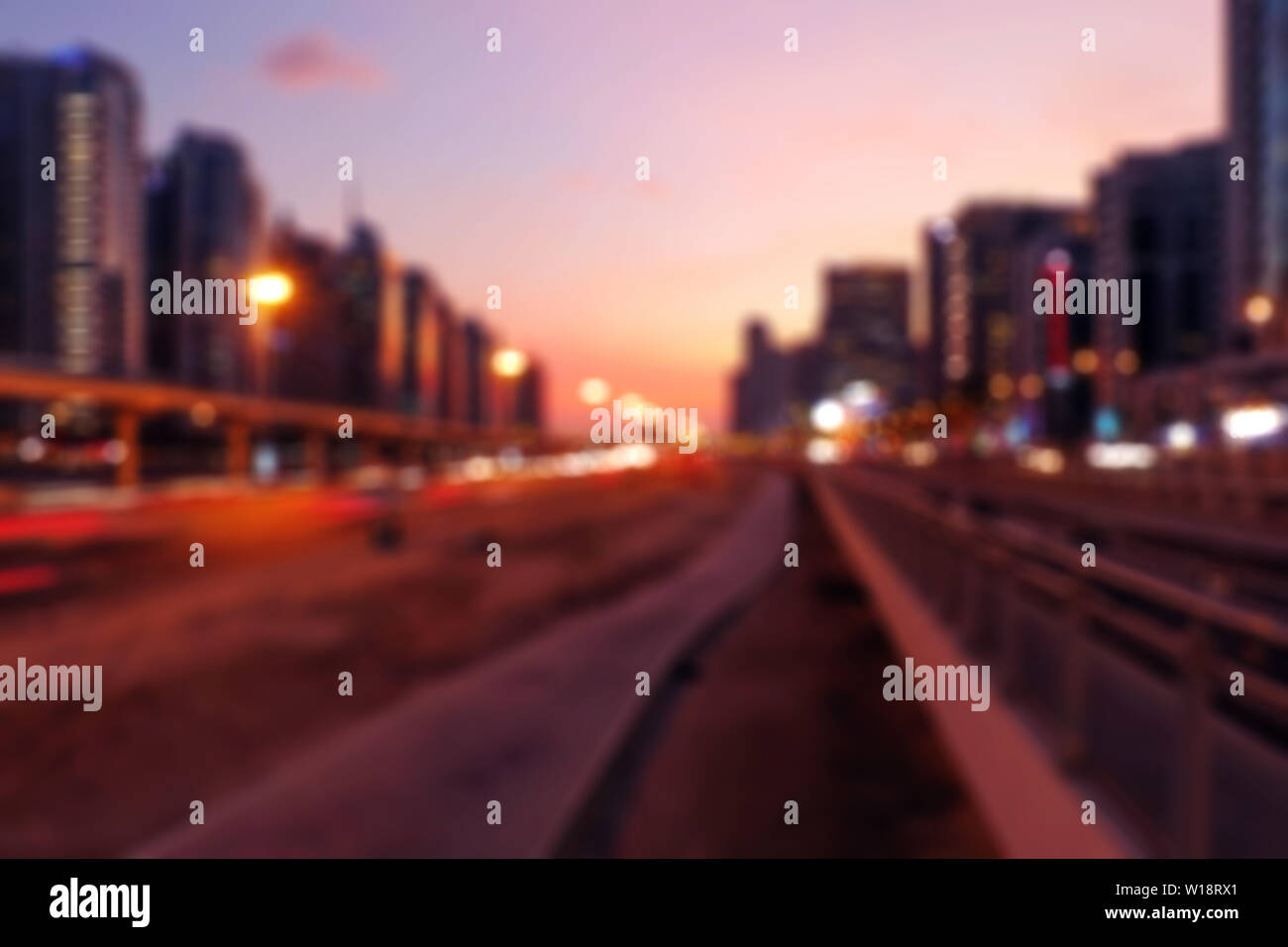 Vintage abstract with sunset city bokeh. Summer party background. Urban cityscape blur background. Modern city summer day bright backdrop. - Stock Image