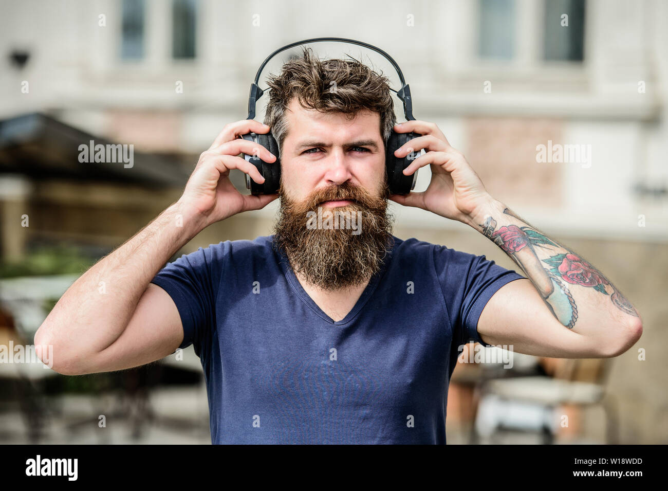 Im online. Soul music. Mature hipster with beard. Enjoying his favorite music. Time stops with nice music. Bearded man. brutal caucasian hipster with moustache. Young and brutal. - Stock Image