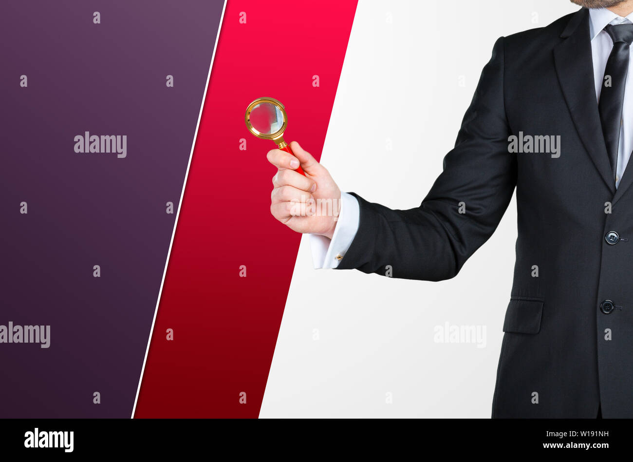 Unrecognizable businessman holding magnifying glass. Business concept Stock Photo