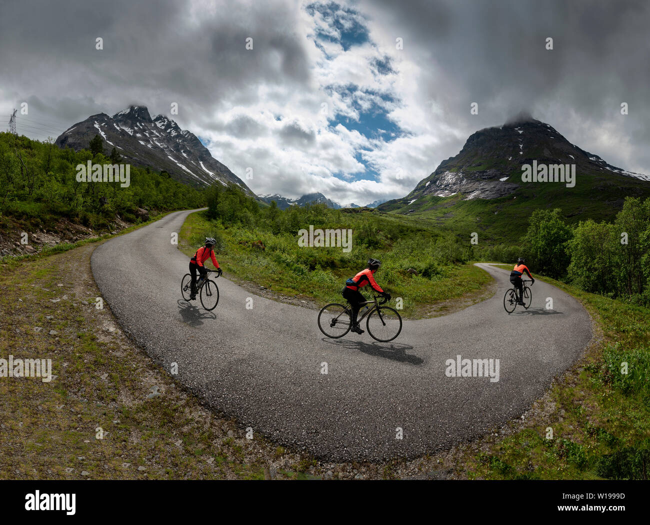 Female cyclist on private toll road through Vengedalen, close to Andalsnes, Norway. Stock Photo