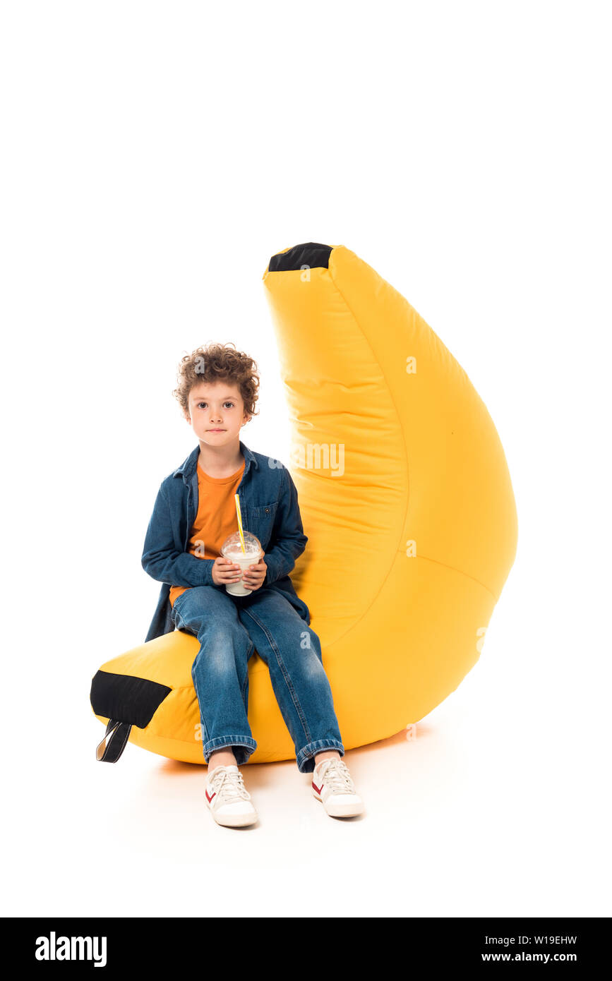 Strange Kid In Casual Clothes Sitting On Bean Bag Chair And Holding Cjindustries Chair Design For Home Cjindustriesco