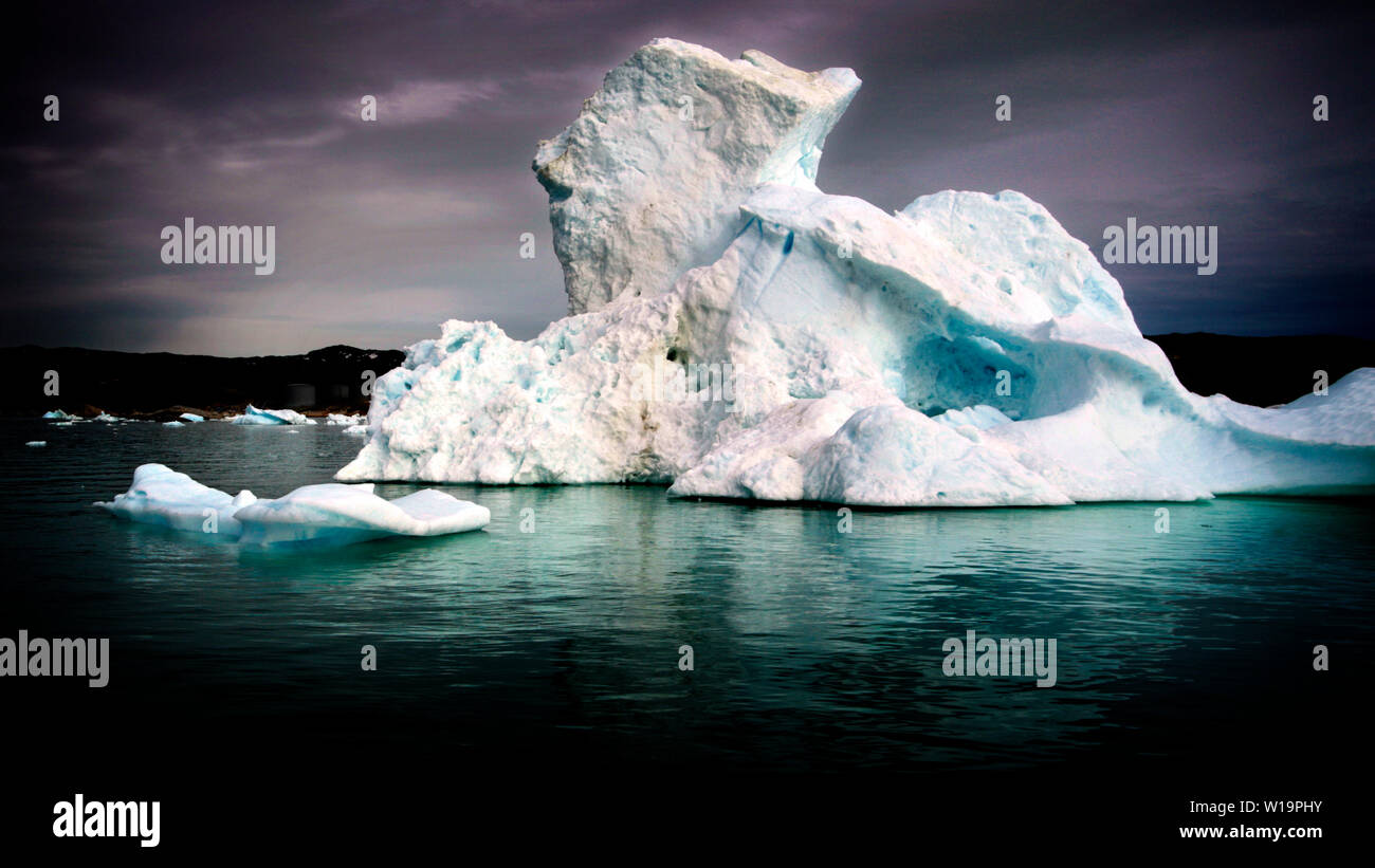 Melting ice from the world's fastest moving glacier, the Jakobshavn Glacier near Ilulissat on Greenland. Global warming have accellerated the melting and calving of the ice bergs. Stock Photo