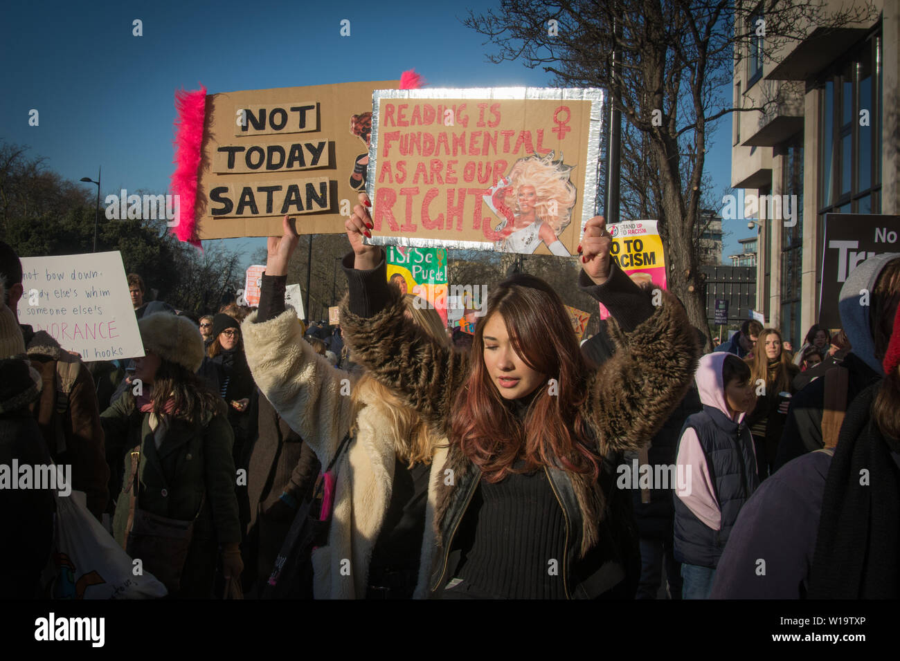 Women's March, London, UK, 21st January 2017. Women carry placards with humerous slogans as people take to the streets in London to protest the day after the inauguration of President Donald Trump. Up to 10,000 took part in London as women worldwide marked the day by marching in an act of international solidarity. Many carried placards referencing statements made by Donald Trump, considered by many as anti-women or otherwise offensive. - Stock Image