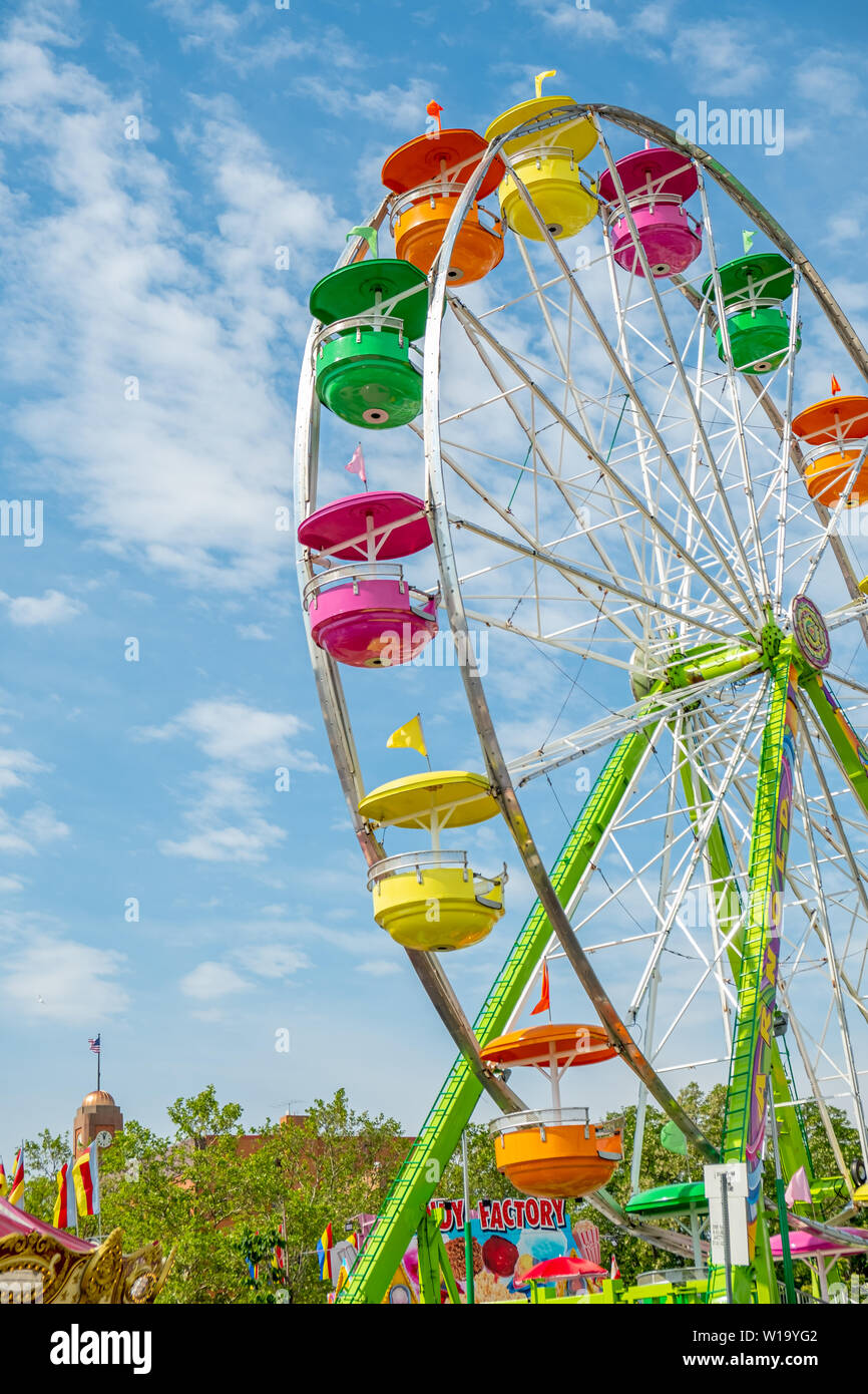 A colorful Ferris Wheel amusement ride in Traverse City, Michigan , part of the National Cherry Festival celebration . Stock Photo