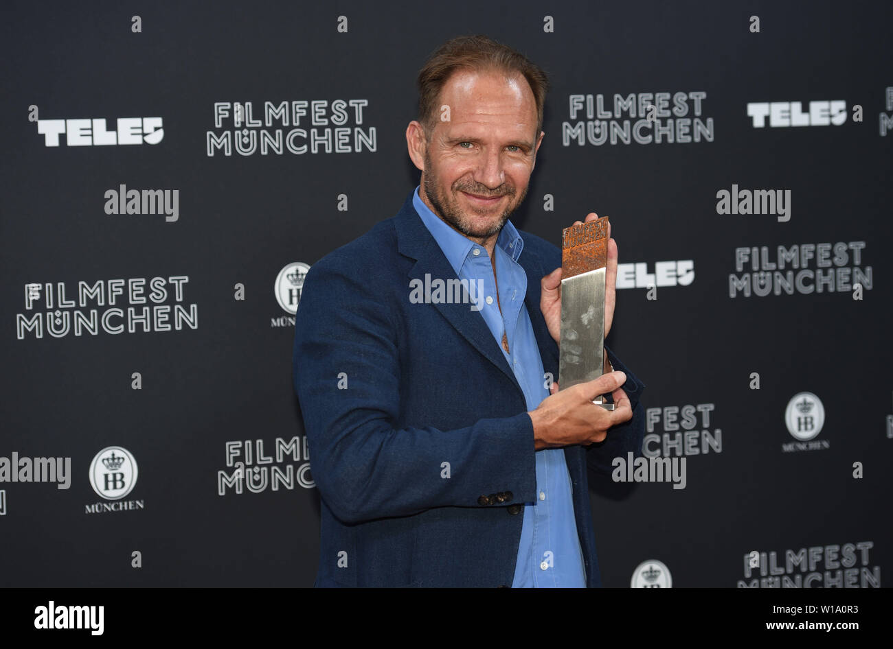 Munich, Germany  01st July, 2019  The actor Ralph Fiennes holds the