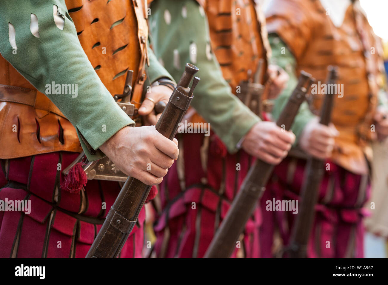 The medieval rifleman soldiers in uniform, in a row, during an historical reenactment in Florence Stock Photo