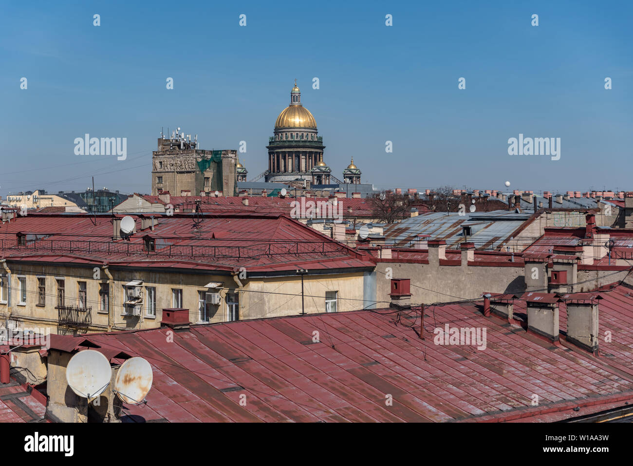 View on roofs of old buildings historic center of Sankt Peterburg and dome of St Isaac Cathedral. Russia - Stock Image