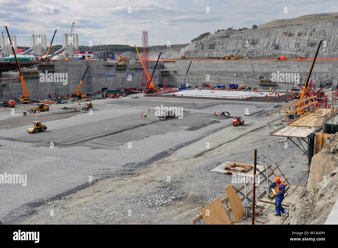Murmansk, Russia. 01st July, 2019. The constuction site of a dry dock, in the village of Belokamenka, Murmansk Region; the construction site is part of Novatek's Kola Shipyard (also known as the Construction Yard for Large-Scale Offshore Structures), which is currently under construction on the shore of Kola Bay, some 12km north of the port of Murmansk, on Russia's Arctic coast. Credit: ITAR-TASS News Agency/Alamy Live News - Stock Image