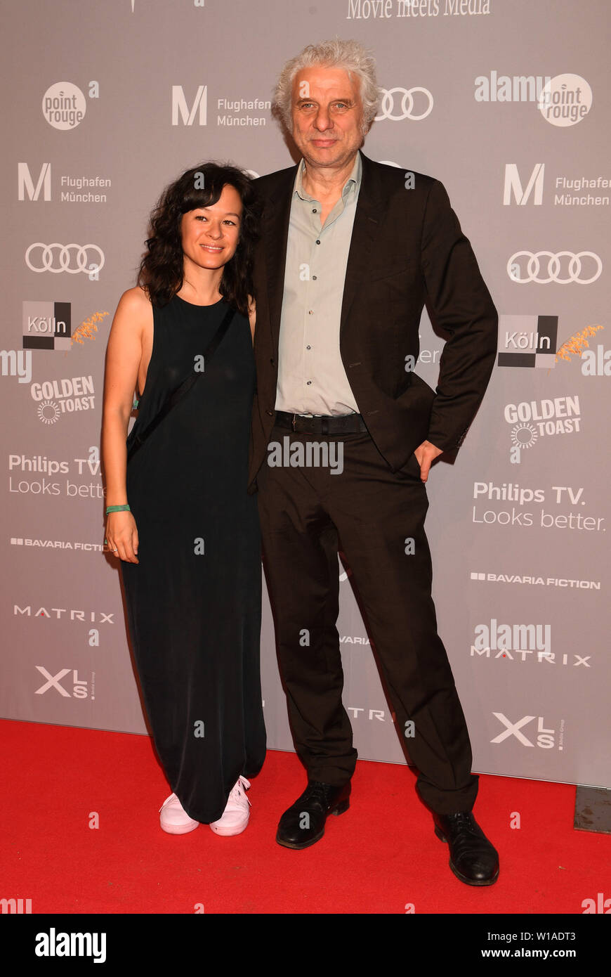 27 June 2019, Bavaria, Munich: The actor Udo Wachtveitl and Lila Schulz stand on the red carpet of the Audi Director's Cut and the industry meeting Movie Meets Media at the Filmfest Munich which takes place from 27.06.2019 to 06.07.2019. Photo: Felix Hörhager/dpa - Stock Image