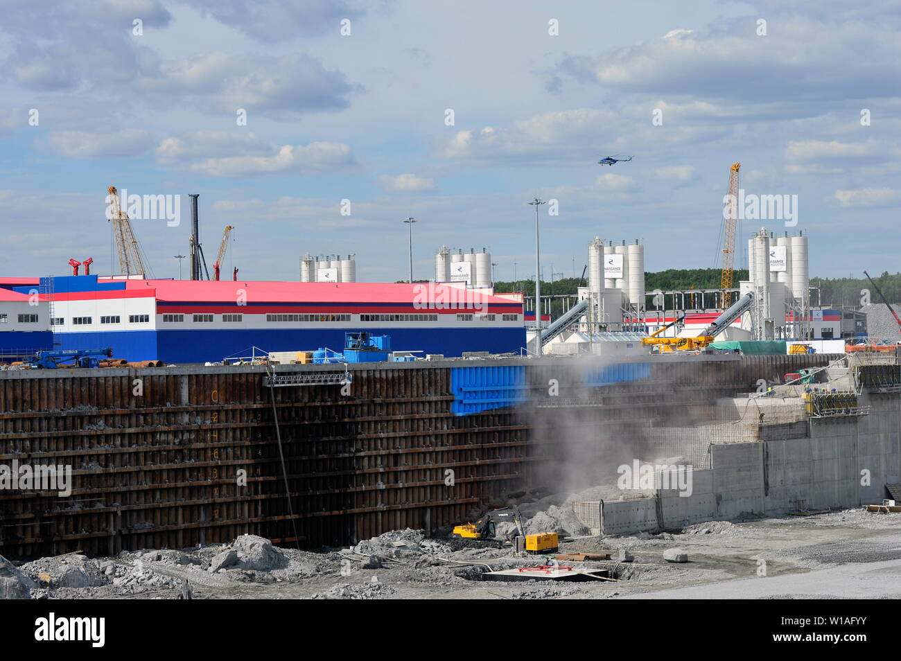 Russia. 01st July, 2019. MURMANSK REGION, RUSSIA - JULY 1, 2019: The construction site of a dry dock, in the village of Belokamenka, Murmansk Region; the construction site is part of Novatek's Kola Shipyard (also known as the Construction Yard for Large-Scale Offshore Structures), which is currently under construction on the shore of Kola Bay, some 12km north of the port of Murmansk, on Russia's Arctic coast. Lev Fedoseyev/TASS Credit: ITAR-TASS News Agency/Alamy Live News - Stock Image