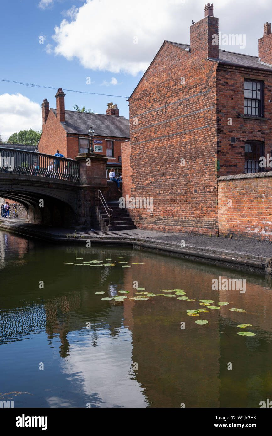 Canal scene with bridge and houses, Black Country Living Museum, Dudley UK - Stock Image