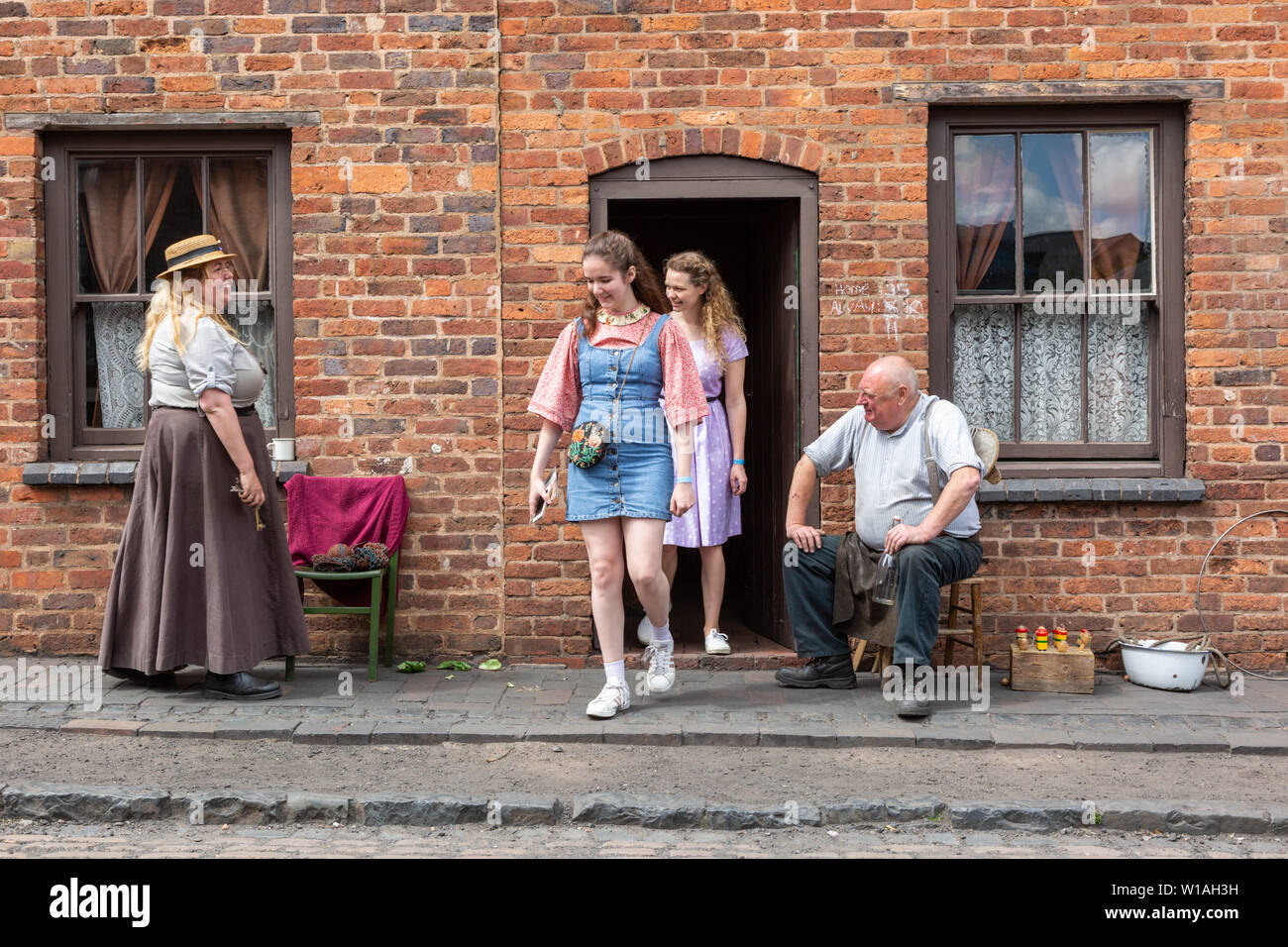 Working class housing street scene, Black Country Living Museum, Dudley UK with tourists. - Stock Image