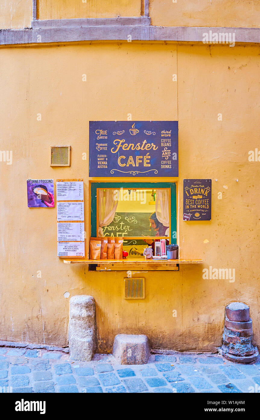 VIENNA, AUSTRIA - FEBRUARY 18, 2019: The small window of famous Fenster Cafe, that offers variety of hot beverages, located in medieval building in hi - Stock Image