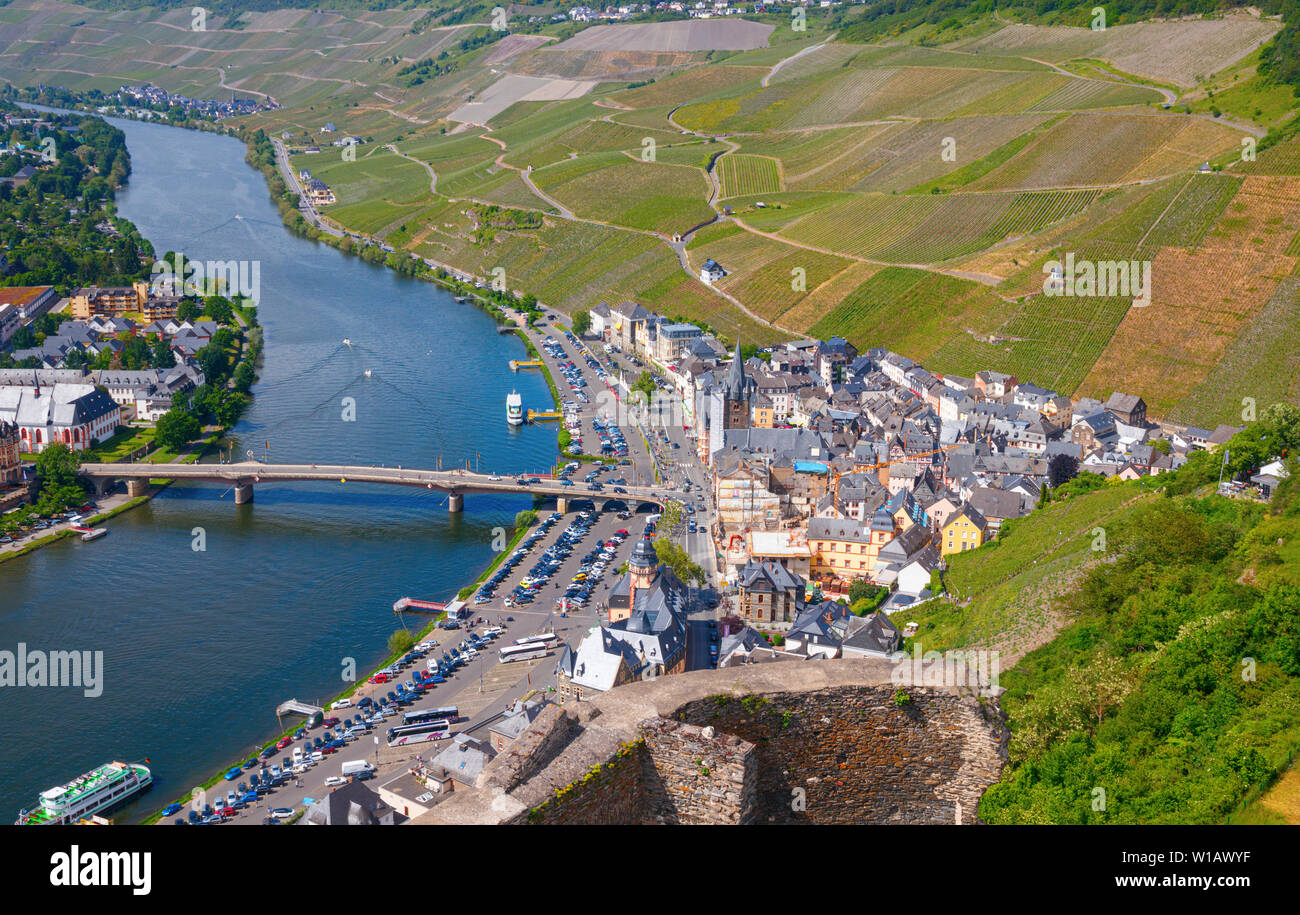 BERNKASTEL, RHINELAND-PALATINATE, GERMANY – MAY 31, 2019: Aerial view of the eastern side of the town, the Moselle river and the surrounding vineyards Stock Photo