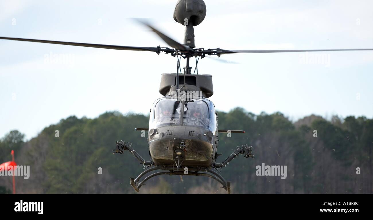 A Bell OH-58D Kiowa Warrior aircraft flies during a flight test performed by the U.S. Army Combat Capabilities Development Command Aviation & Missile Center's Aviation Development Directorate-Eustis at Joint Base Langley-Eustis, Virginia, Jan. 28. Stock Photo