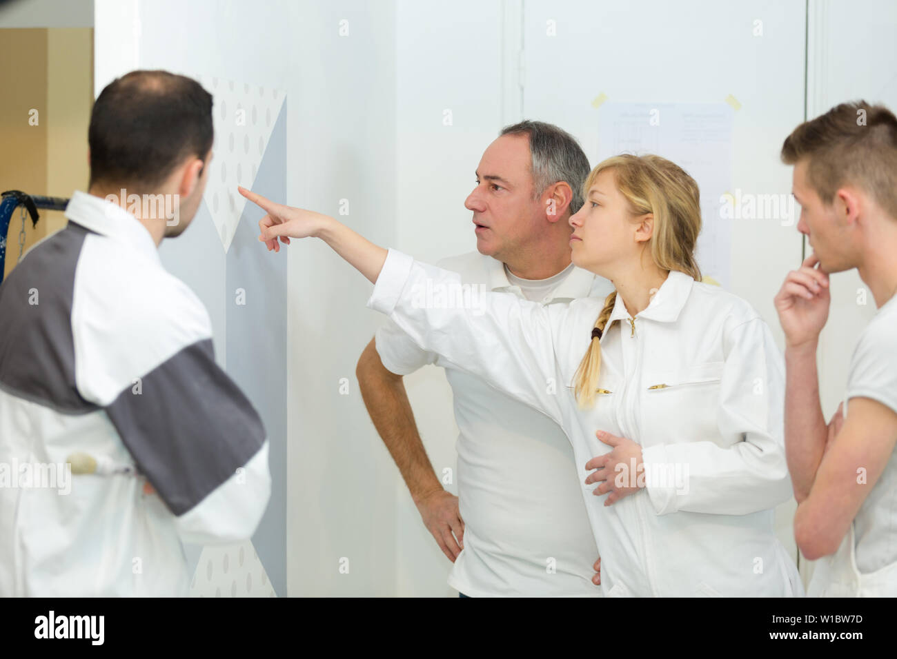 co-workers apprentice during class - Stock Image