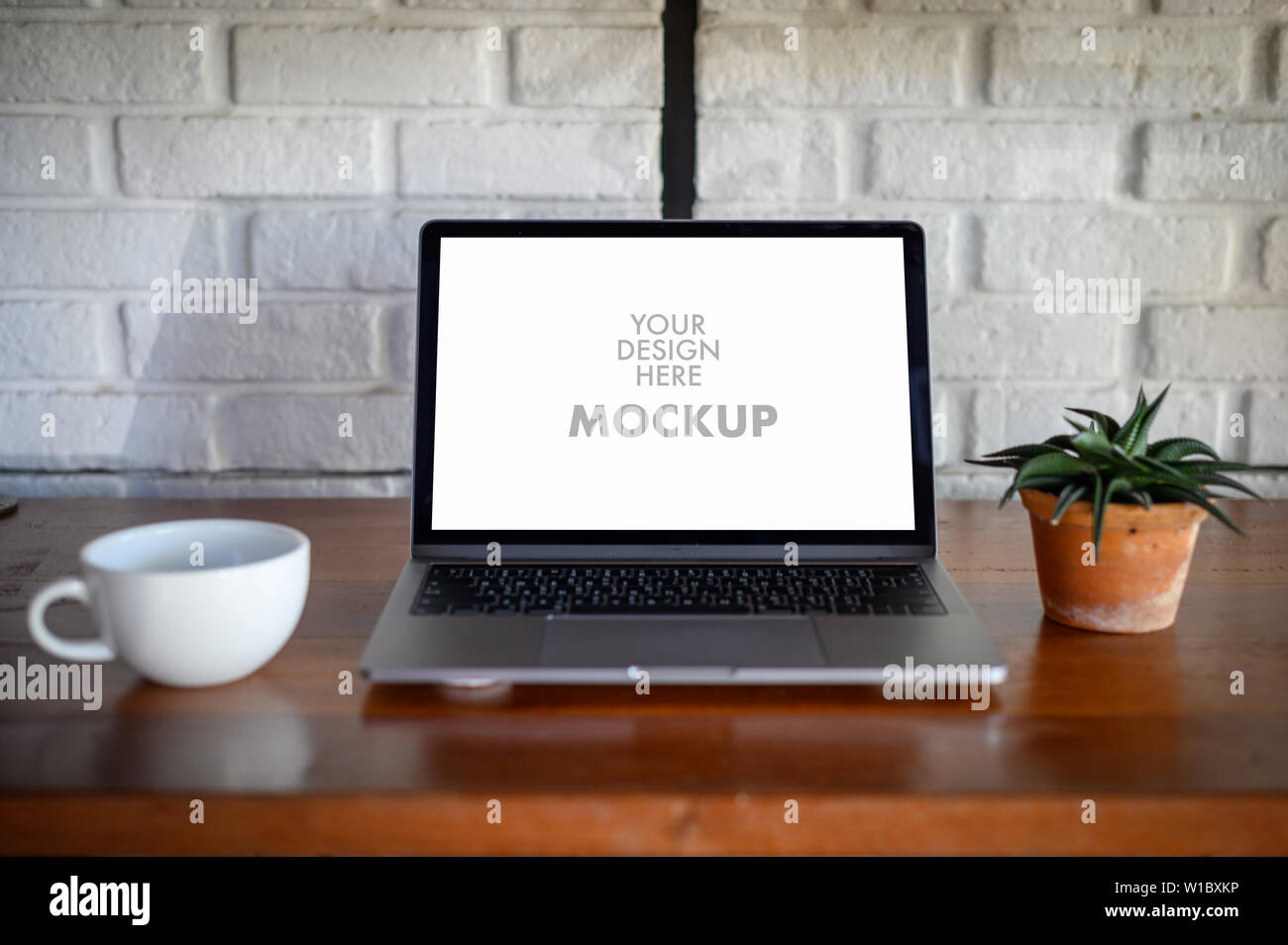Mockup of business man using laptop screen for your advertising text message Laptop with blank screen on table compute work Stock Photo