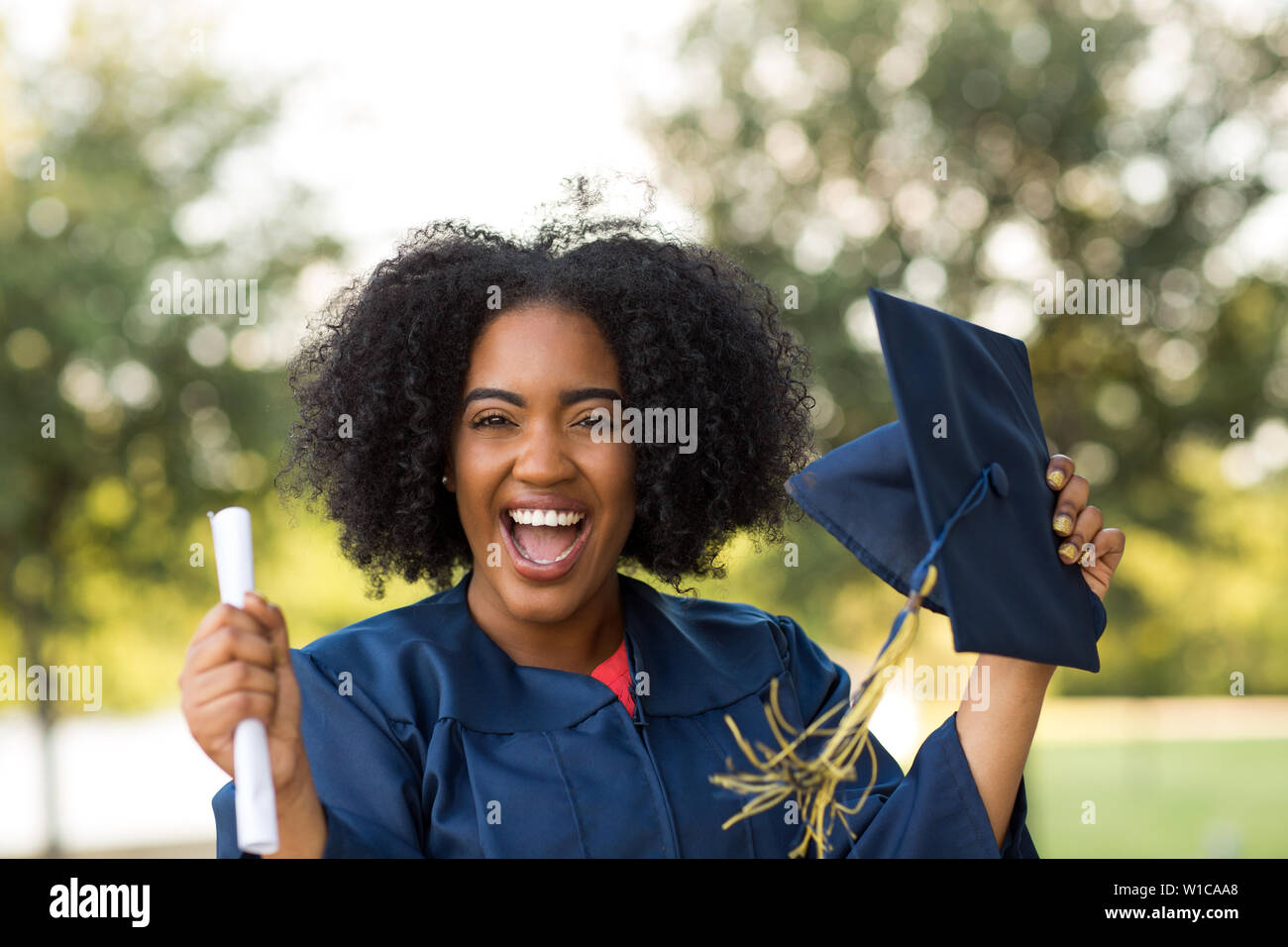 Confident African American woman at her graduation. - Stock Image