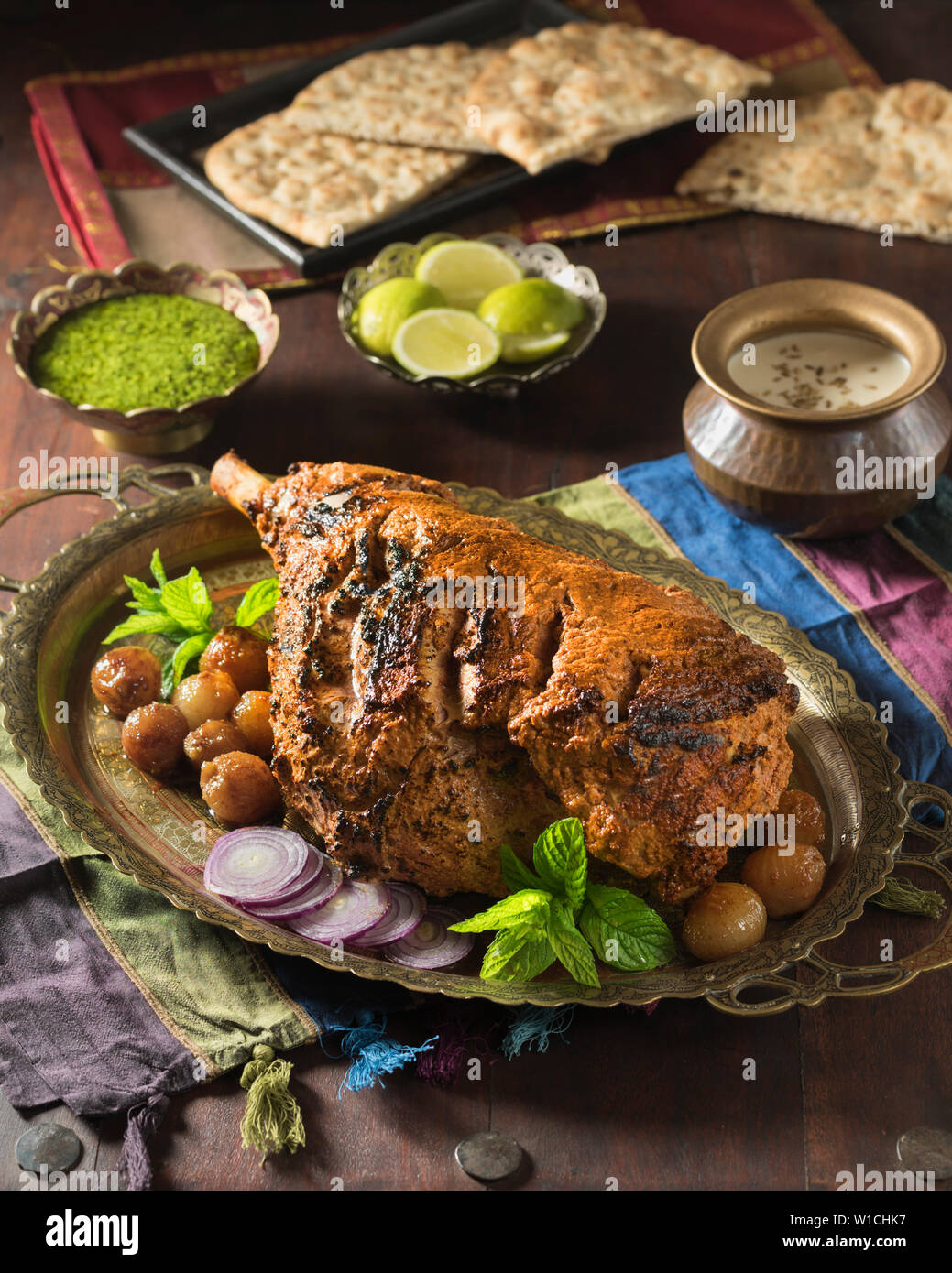 Raan masaledar. Roast spiced leg of lamb. India Food - Stock Image