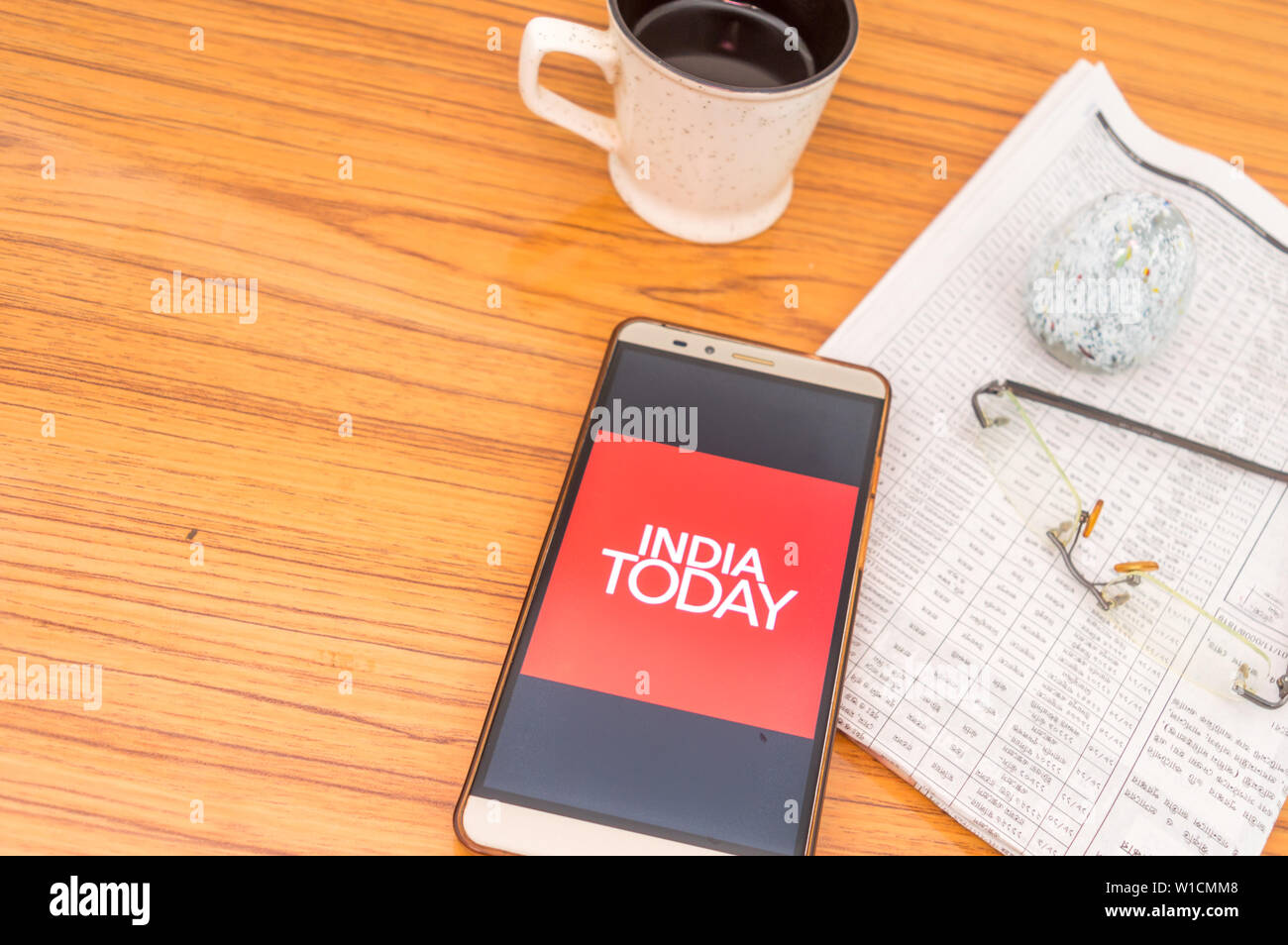 Kolkata, India, February 3, 2019: India Today news app (application) visible on mobile phone screen beautifully placed over a wooden table with newspa Stock Photo