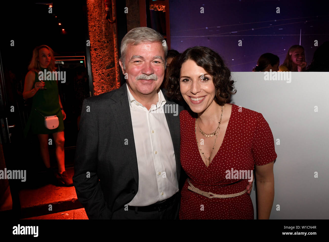 01 July 2019, Bavaria, Munich: Producer Alexander Ollig and actress Eva-Maria Reichert celebrate at the Audi Director's Cut and the Movie Meets Media industry get-together at Filmfest München, which takes place from 27.06.2019 to 06.07.2019. Photo: Felix Hörhager/dpa - Stock Image