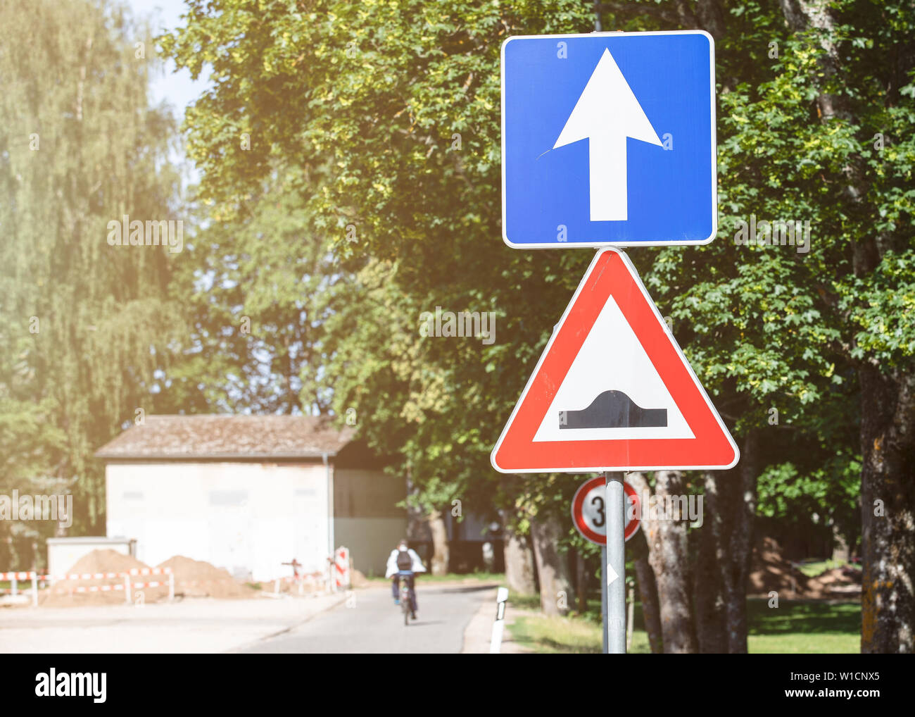 Bumpy road traffic sign - Stock Image