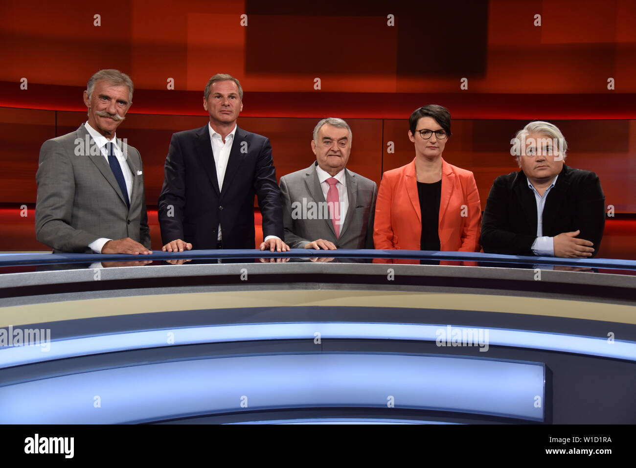 01 July 2019, North Rhine-Westphalia, Cologne: Uwe Junge, l-r, Georg Mascolo, Herbert Reul, Irene Mihalic and Mehmet Daimagüler on the ARD talk show 'Hart aber Fair' on 01.07.2019 in Cologne with the theme 'Words become shots: How dangerous is right hatred? ' Photo: Horst Galuschka/dpa/Horst Galuschka dpa - Stock Image