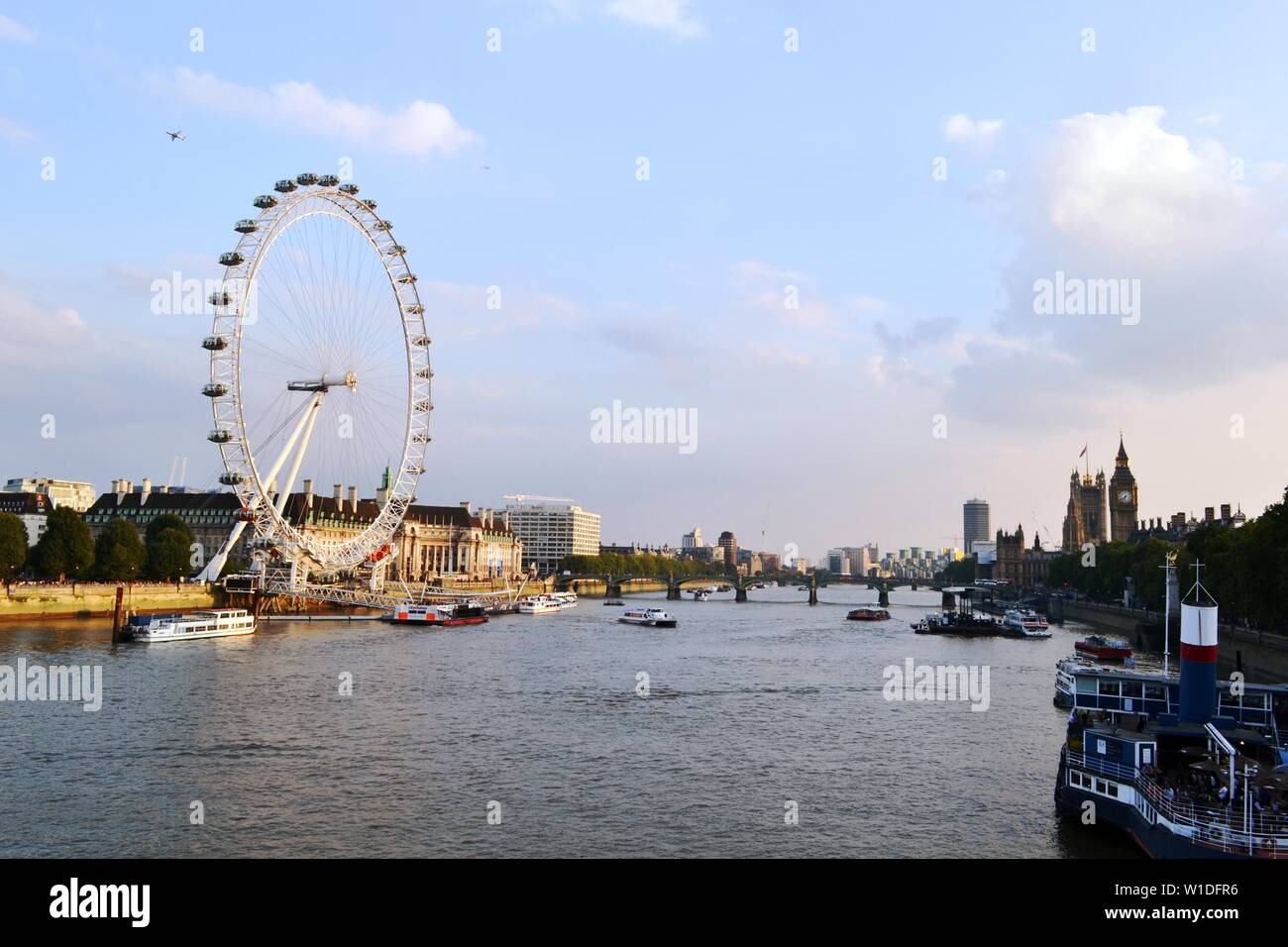 London/UK - September 7, 2014: Panoramic View to London Eye, Thames river, Houses of Parliament, Westminster bridge, Big Ben at sunset. Stock Photo