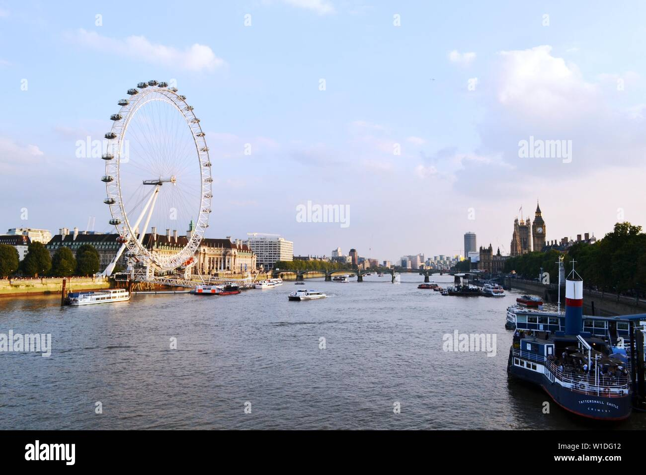 London/UK - September 7, 2014: Panoramic View to London Eye, Thames river, Houses of Parliament, Westminster bridge, Big Ben at sunset. Stock Photo