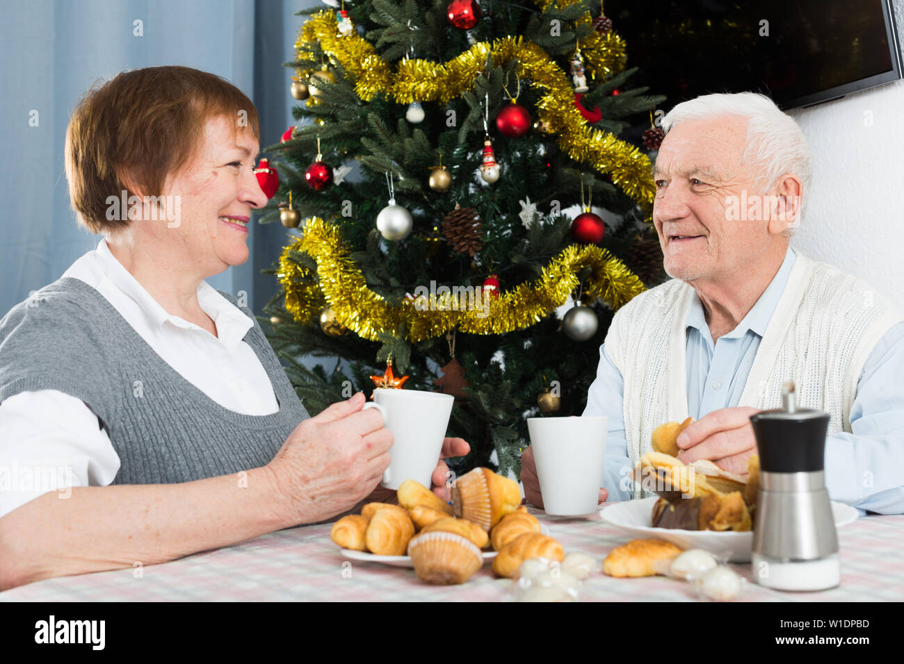 Mature husband and wife happy to spend Christmas together at home - Stock Image