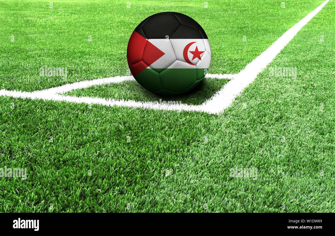soccer ball on a green field, flag of Western Sahara - Stock Image