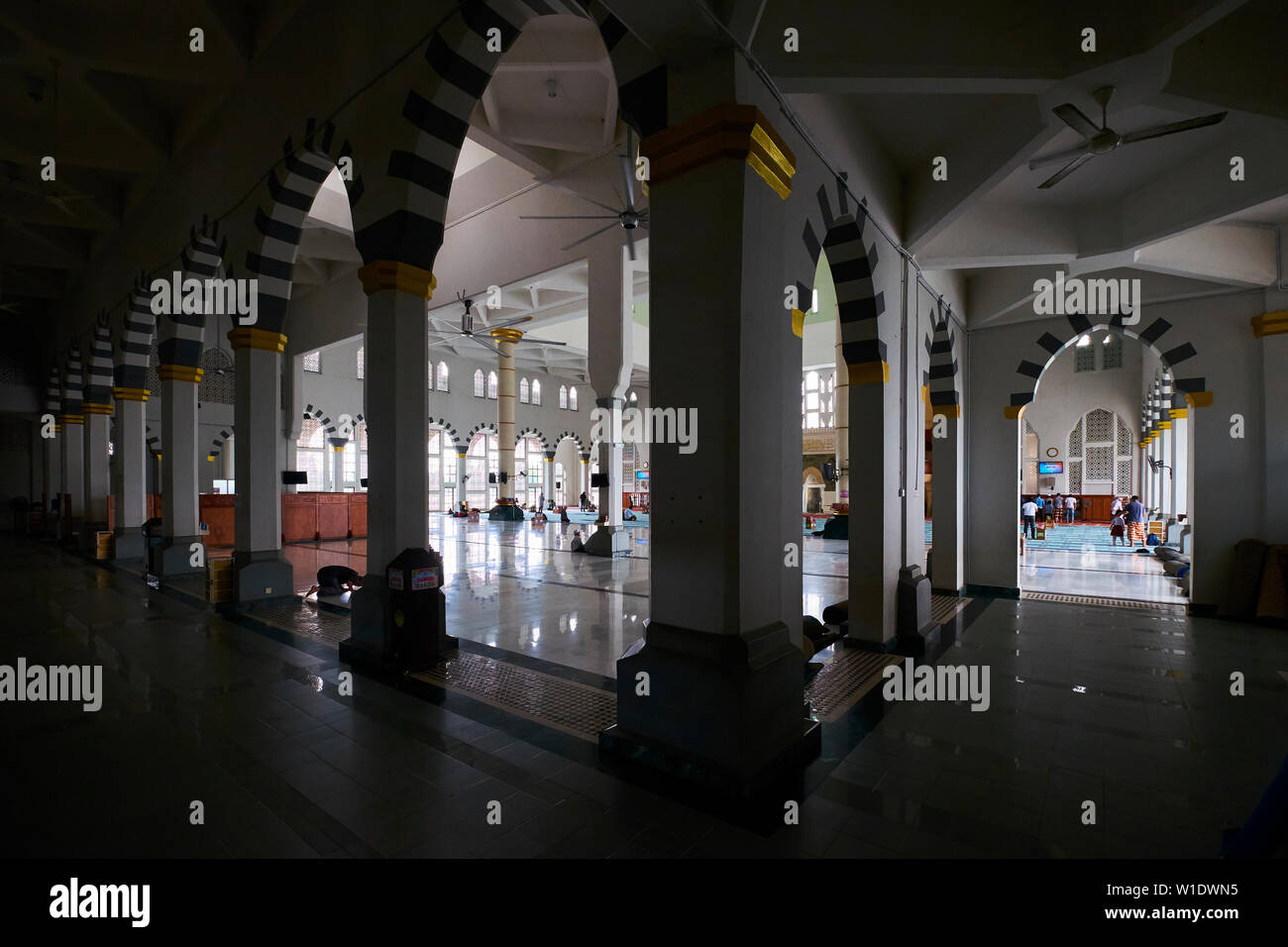 Inside the central courtyard space at the Moorish style main city Mosque, Masjid Bandaraya, in Kota Kinabalu, Borneo, Malaysia. - Stock Image