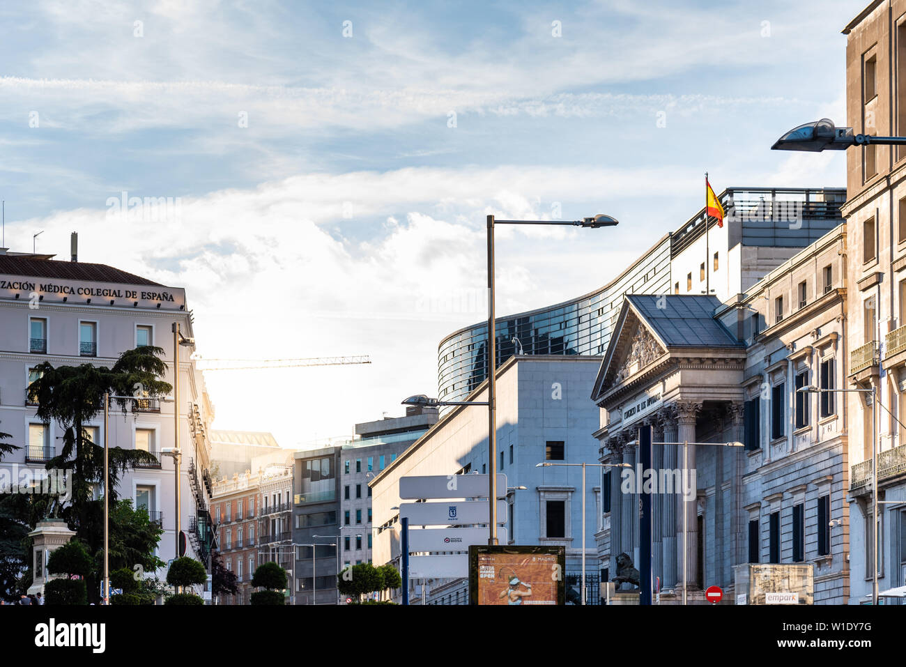Madrid, Spain - April 14, 2019: Scenic view of the Congress of Deputies of Spain in Madrid a sunny day with sun flares at evening. Stock Photo