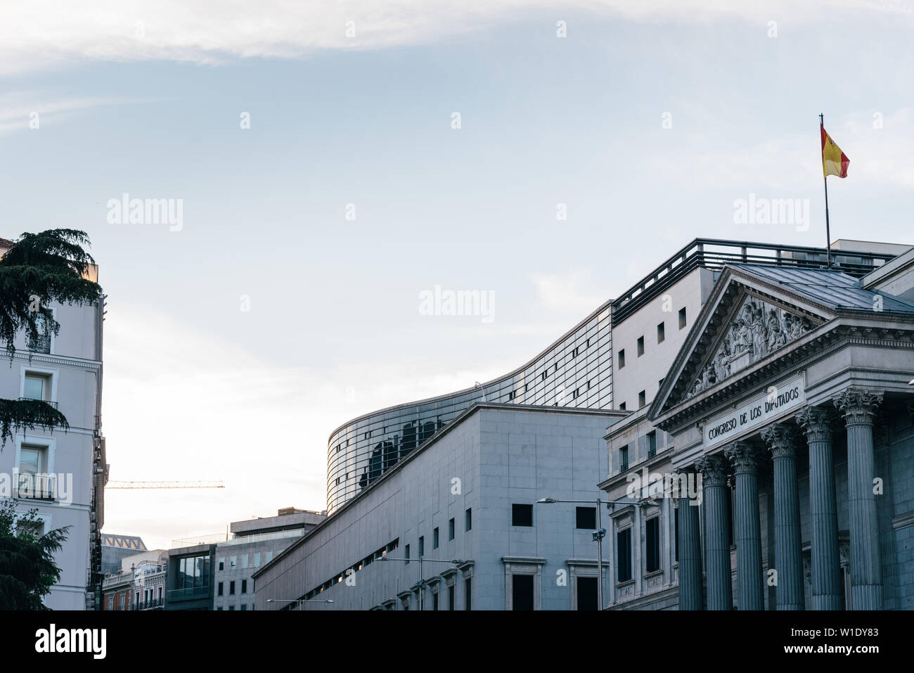 Madrid, Spain - April 14, 2019: View of the Congress of Deputies of Spain in Madrid at evening. Stock Photo
