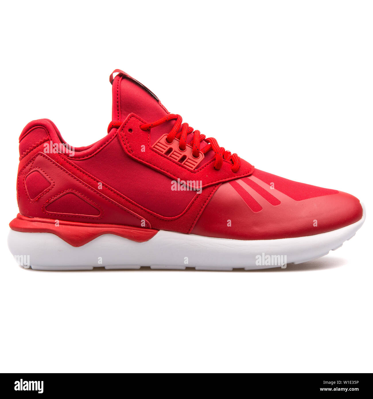 VIENNA, AUSTRIA - AUGUST 25, 2017: Adidas Tubular Runner red and white sneaker on white background. Stock Photo