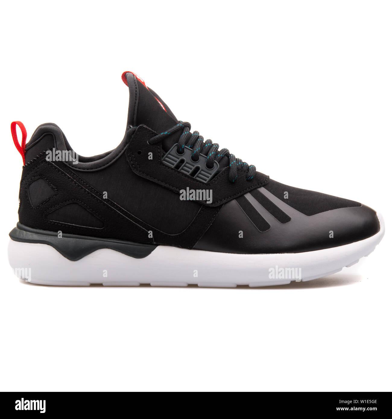 VIENNA, AUSTRIA - AUGUST 25, 2017: Adidas Tubular Runner Weave black and white sneaker on white background. Stock Photo