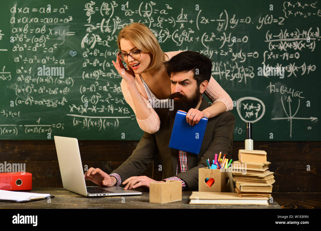 E-learning Online Study Learning Concept, E-learning education and university concept, Tutor asks the tutee to find the definition in the textbook, Te - Stock Image