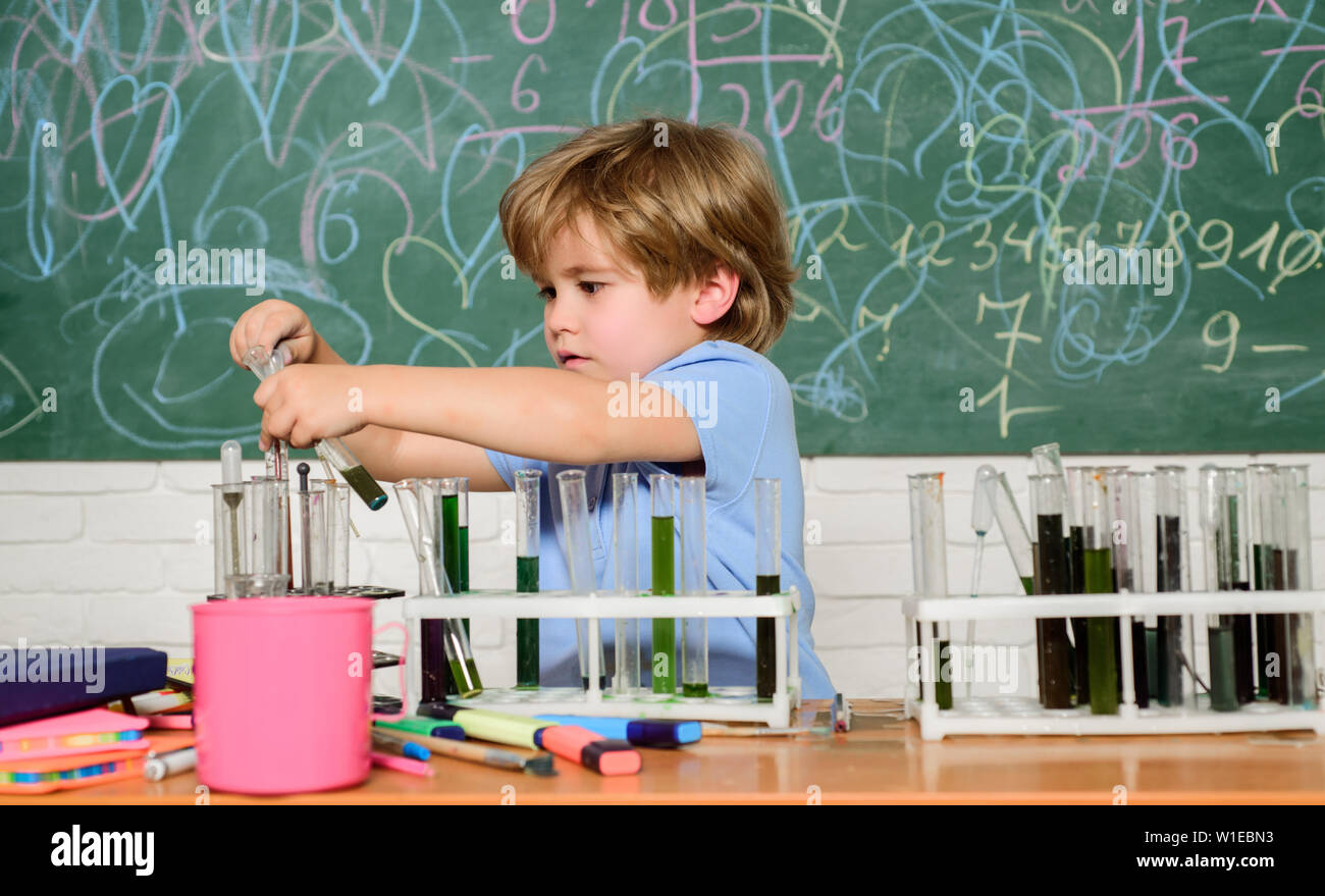 Wunderkind and early development. Study grants and scholarship. Smart children performing chemistry test. Small pupil learning chemistry in school. Chemistry laboratory. Practical knowledge concept. - Stock Image